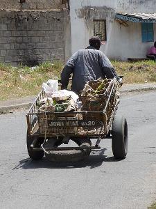 man pulling a mkokoteni cart